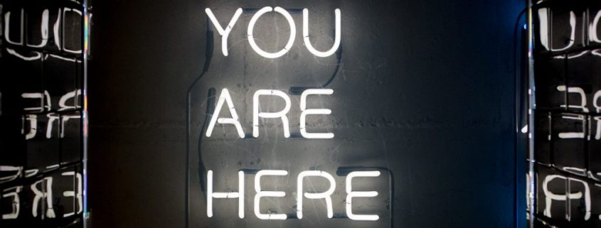 sign that reads, you are here
